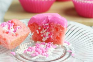 pink cupcakes with pink icing and sprinkles